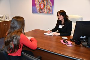 Specialist family lawyer Claire Holland speaking to a client.