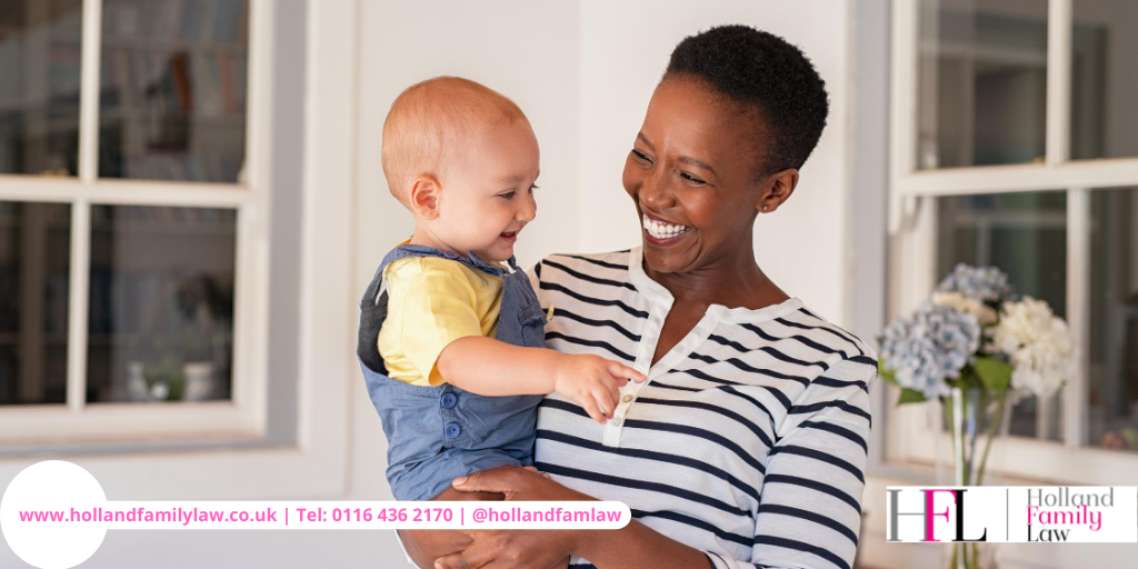 Woman holding a child job after securing a special guardianship order.