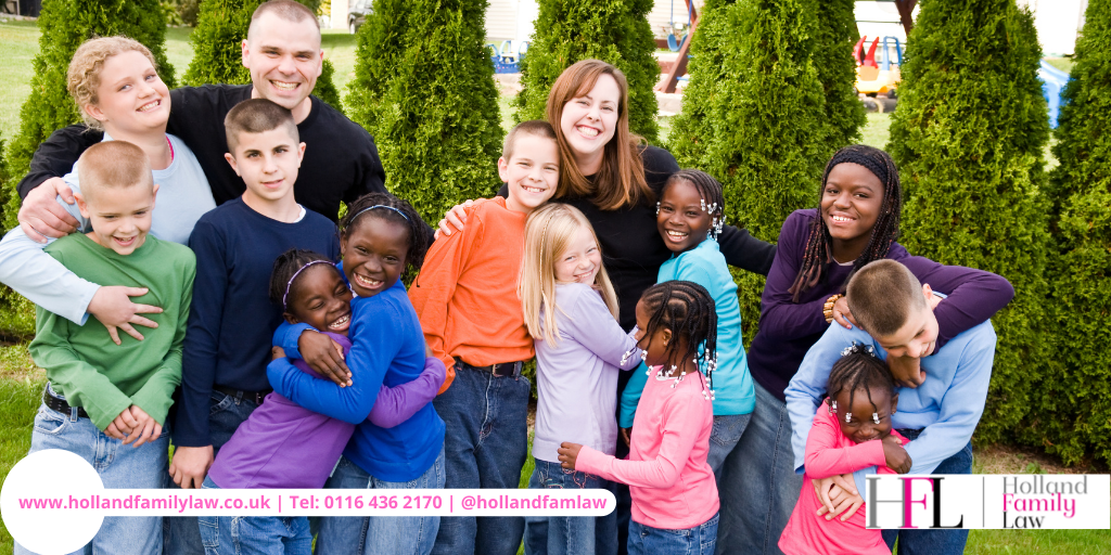 A group of families whose adoption application was successful.